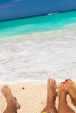 Male and female legs on tropical beach Royalty Free Stock Image