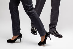 Male and female legs walking Stock Images