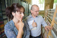 Male and female managers inspecting weaver factory. Male Royalty Free Stock Photo