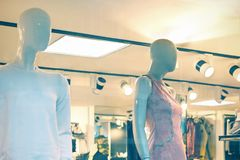 Male and female mannequins in the window of a clothing shop. Shopping day. Toned photo Royalty Free Stock Images
