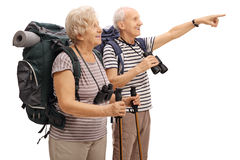 Male and female mature hiker with one of them pointing Royalty Free Stock Photography