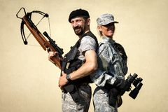 Male and female military persons Royalty Free Stock Photography