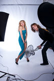Male and female models in photographic studio Royalty Free Stock Image
