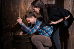 Male and female opened a barrel and trying to solve a conundrum. To get out of the trap, escape the room game concept Stock Photo