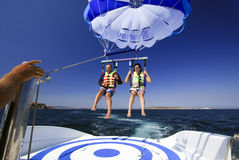 Male and female parasailing. royalty free stock photo