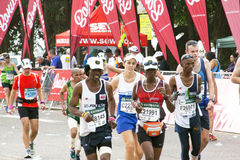 Male and Female Participants Running in the 2014 Comrades Marath Stock Image