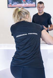 Male an female personal trainers Stock Photography
