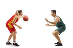 Male and female playing basketball. Isolated on white background royalty free stock image