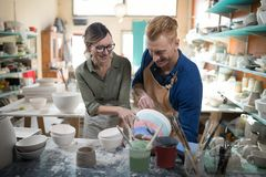 Male and female potter interacting with each other Royalty Free Stock Images