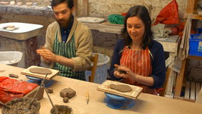 Male and female potters molding a clay stock video