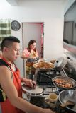 Home life : asia, cooking, preparing food, day, indoors people kitches Royalty Free Stock Images