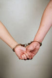 Male and female prisoner holding hands Stock Image