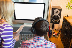 Male and female radio hosts in studio Stock Image