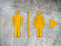 Male and Female Restroom sign. On Polished wall Stock Images