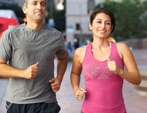 Male And Female Runners On Urban Street Royalty Free Stock Photos