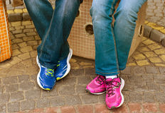 Male and female's feet with shoes Stock Image