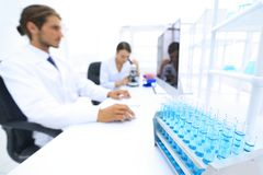Side view of scientists working in laboratory. Male And Female Scientists Using Microscopes In Laboratory Stock Images