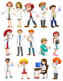 Male and female scientists in white gown Stock Photos