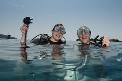Male and female scuba divers. Scuba divers on surface after a dive Stock Photo