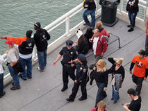 Male and female SFPD police officers walk down promenade along w Stock Image