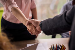 Male and female shaking hands on business deal. Stock Photo