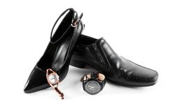 Male and female shoes. With watches Stock Photography