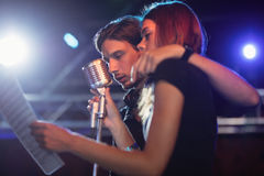 Male and female singers performing at nightclub Stock Image