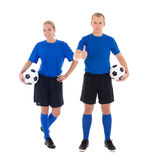 Male and female soccer players in blue uniform with a balls on w. Male and female soccer players in blue uniform with a balls isolated on white background Royalty Free Stock Photos