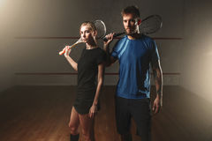 Male and female squash game players with rackets Stock Photo