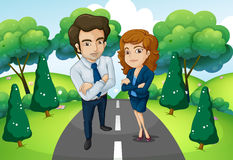 A male and a female standing in the middle of the road Royalty Free Stock Photos
