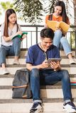 Male and female students intend to read book. At university, Education concept Stock Images