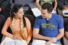 Male And Female Students Looking At Each Other Royalty Free Stock Photo
