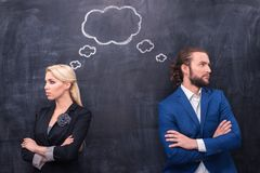 Male and female thinking together on th blackboard Royalty Free Stock Photo