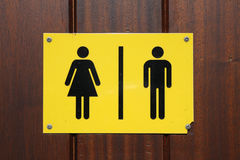 Male and female toilet sign. Yellow and black male and female toilet sign royalty free stock image