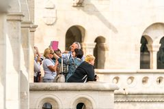 Male and female tourist standing at a viewpoint outside and below Matthias Church in Budapest. Budapest, Hungary - September 27, 2017: Selective focus side view Royalty Free Stock Photos