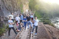 Male and female tourists visit the railway of death in the history of World War 2. KANCHANABURI, THAILAND - JANUARY 14: Male and female tourists visit the royalty free stock image