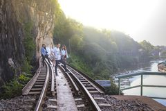 Male and female tourists visit the railway of death in the history of World War 2. KANCHANABURI, THAILAND - JANUARY 14: Male and female tourists visit the royalty free stock photo