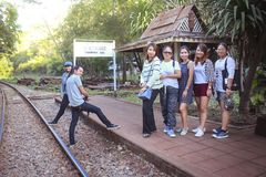 Male and female tourists visit the railway of death in the history of World War 2. KANCHANABURI, THAILAND - JANUARY 14: Male and female tourists visit the royalty free stock photography