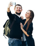 Male and female travelers with backpack make selfie on phone Royalty Free Stock Image