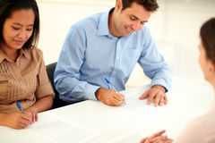 Male and female worker signing a contract Stock Photos