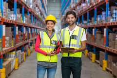 Male and female worker standing together Stock Photo