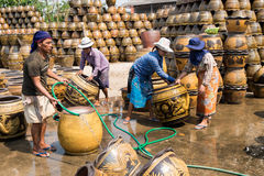 Male and female workers washing Dragon pattern flower pots. Stock Photo