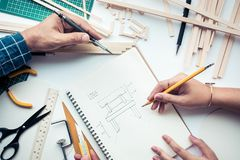Male and female working on worktable with wood material.Diy. Male and female working on worktable with balsa wood material.Diy,design project,invention concept Royalty Free Stock Image