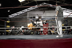 Male and female wrestlers in combat at the Cholitas Wrestling Royalty Free Stock Images