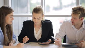 Male and females company workers are working with documents. stock footage