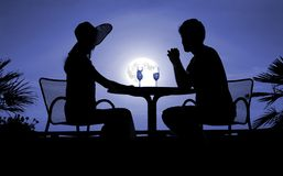 Male and feminine silhouettes in the night Stock Photography