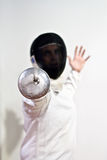 Male Fencer. A white Fencer Lunging frontward to attack Stock Photography
