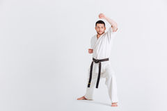 Male fighter in kimono warming up Stock Photos