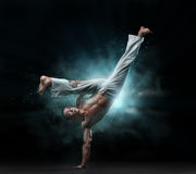 Male fighter trains capoeira Stock Images