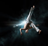Male fighter trains capoeira Royalty Free Stock Image